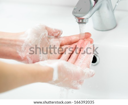 Washing of female hands with soap in bathroom close up - stock photo