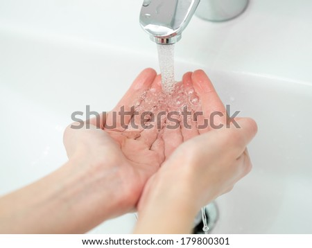 Washing of hands in bathroom close up - stock photo
