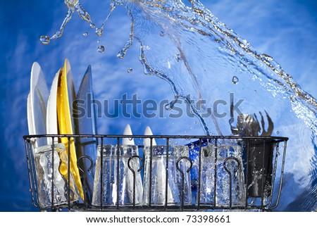 Washing plates in the dishwasher. Inside a dishwasher - stock photo