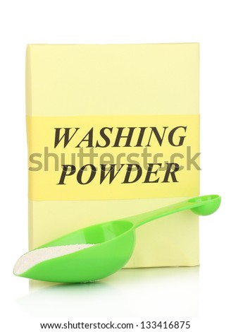 Washing powder and measuring cup isolated on white - stock photo
