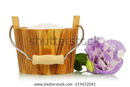 Washing powder in wooden basket and flower - stock photo