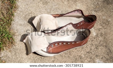 Washing sneakers sun - stock photo