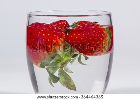 Washing strawberries with water