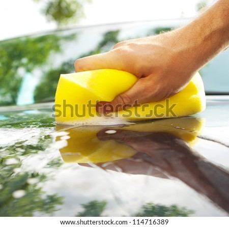 washing the car with hand - stock photo