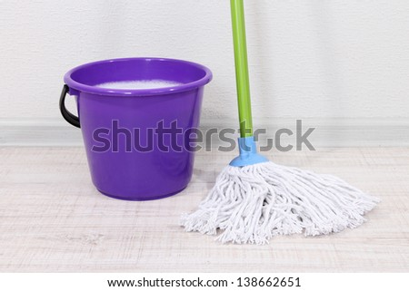 Washing the floor and all floor cleaning - stock photo