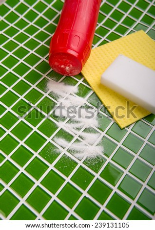 washing the tiles in the bathroom, cleaning kit apartment, hygienic cleaning, gloves, sponge and powder - stock photo
