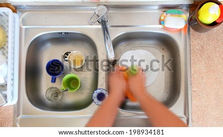 washing-up bowl in kitchen indoor cup person cleaning the sink - stock photo