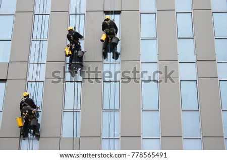 Washing windows on a skyscraper