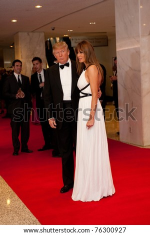 WASHINGTON - APRIL 30: Donald Trump and wife Melania arrive at the White House Correspondents Dinner April 30, 2011 in Washington, D.C. - stock photo