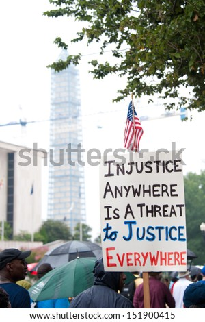 WASHINGTON - AUGUST 28: A quote from Martin Luther King, Jr. appears on a sign at  the commemoration of the 50th anniversary of the March on Washington August 28, 2013 in Washington DC. - stock photo
