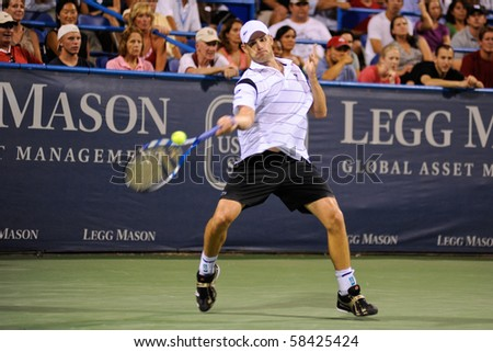 WASHINGTON - AUGUST 3: Andy Roddick (USA) defeats Grega Zemlja (SLO, not pictured) at the Legg Mason Tennis Classic on August 3, 2010 in Washington. - stock photo