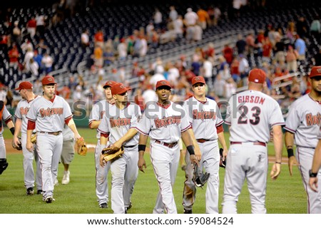 WASHINGTON - AUGUST 14: Arizona Diamondbacks players after the Diamondbacks' win against the  Washington Nationals on August 14, 2010 in Washington. - stock photo