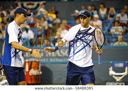 WASHINGTON - AUGUST 4: Bob and Mike Bryan (USA) at the Legg Mason Tennis Classic on August 4, 2010 in Washington.   The Bryan brothers defeated Andrew Courtney and Michael Shabaz (USA, not pictured). - stock photo