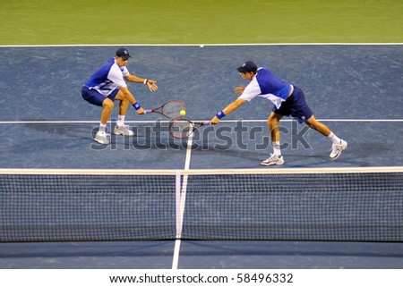 WASHINGTON - AUGUST 4: Bob and Mike Bryan (USA) play against Andrew Courtney and Michael Shabaz (USA) at the Legg Mason Tennis Classic on August 4, 2010 in Washington. The Bryan brothers won. - stock photo
