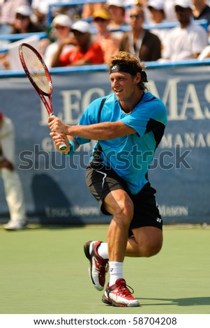 WASHINGTON - AUGUST 8: David Nalbandian (ARG) defeats Marcos Baghdatis (CYP, not pictured) to win the Legg Mason Tennis Classic on August 8, 2010 in Washington. - stock photo