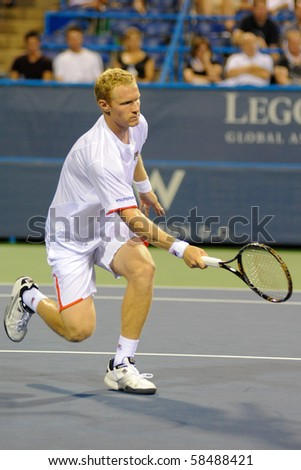WASHINGTON - AUGUST 4: Dmitry Tursunov (RUS) is defeated by Wimbledon finalist Tomas Berdych (CZE) in second round action at the Legg Mason Tennis Classic on August 4, 2010 in Washington. - stock photo