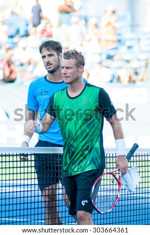 WASHINGTON - AUGUST 5: Feliciano Lopez (ESP) and Lleyton Hewitt (AUS) after Lopez's win at the Citi Open tennis tournament on August 5, 2015 in Washington DC   - stock photo