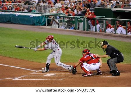 WASHINGTON - AUGUST 14: Gerardo Parra of the Arizona Diamondbacks swings at a pitch at an away game against the Washington Nationals on August 14, 2010 in Washington. - stock photo