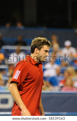 WASHINGTON - AUGUST 5: Gilles Simon (FRA) during his stunning elimination of Andy Roddick (USA, not pictured) from the Legg Mason Tennis Classic on August 5, 2010 in Washington. - stock photo