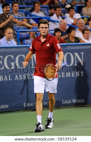WASHINGTON - AUGUST 5: Gilles Simon (FRA) reacts to eliminating Andy Roddick (USA, not pictured) from the Legg Mason Tennis Classic on August 5, 2010 in Washington. - stock photo
