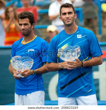 WASHINGTON  AUGUST 3: Jean-Julien Rojer (NED) and Horia Tecau (ROU) take the doubles final title at the Citi Open tennis tournament on August 3, 2014 in Washington DC - stock photo