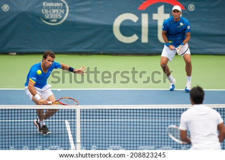 WASHINGTON  AUGUST 3: Jean-Julien Rojer (NED) hits the ball during his successful doubles final match with partner Horia Tecau (ROU) at Citi Open tennis tournament on August 3, 2014 in Washington DC - stock photo