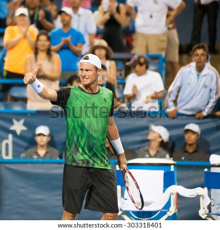 WASHINGTON - AUGUST 4:  Lleyton Hewitt (AUS) celebrates his win over John-Patrick Smith (AUS, not pictured) at the Citi Open tennis tournament on August 4, 2015 in Washington DC  - stock photo