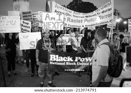 WASHINGTON - AUGUST 30: Marchers rally against racism after the shooting death of Mike Brown in Ferguson, Missouri.  The march took place in Washington, DC on August 30, 2014 - stock photo