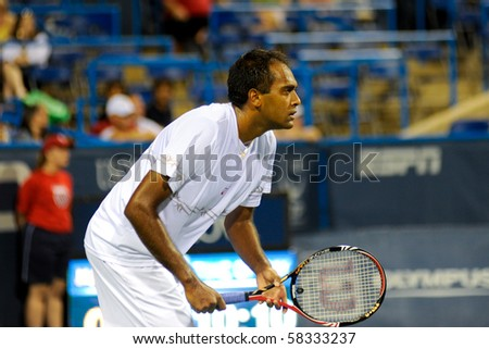 WASHINGTON - AUGUST 2: Rajeev Ram (USA) plays in a first round match against David Nalbandian (ARG) at the Legg Mason Tennis Classic on August 2, 2010 in Washington.  Nalbandian defeated Ram. - stock photo