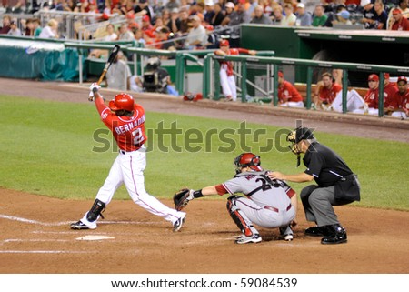 WASHINGTON - AUGUST 14: Roger Bernadina of the Washington Nationals swings at a pitch in the Nationalsâ?' home game against the Arizona Diamondbacks on August 14, 2010 in Washington. - stock photo
