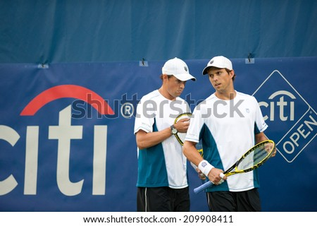 WASHINGTON - AUGUST 1: The Bryan brothers (USA) fall to Steve Johnson and Sam Querrey (USA, not pictured) in men's doubles action at the Citi Open tennis tournament on August 1, 2014 in Washington DC - stock photo