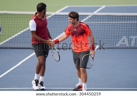 WASHINGTON - AUGUST 8: The doubles team of Bopanna and Mergea  fall to Bob and Mike Bryan (USA, not pictured) in the semifinals at the Citi Open tennis tournament on August 8, 2015 in Washington DC  - stock photo