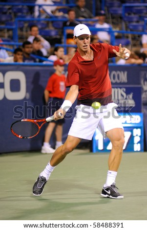 WASHINGTON - AUGUST 4: Wimbledon finalist Tomas Berdych (CZE) defeats Dmitry Tursunov (RUS) in second round action at the Legg Mason Tennis Classic on August 4, 2010 in Washington. - stock photo