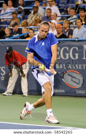 WASHINGTON - AUGUST 5: Xavier Malisse (BEL) defeats John Isner (USA, not pictured) at the Legg Mason Tennis Classic on August 5, 2010 in Washington. - stock photo