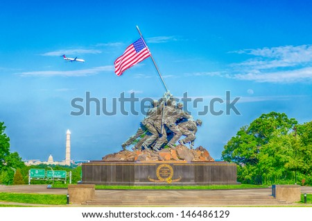 "WASHINGTON - CIRCA MAY 2013: The Marine Corps War Memorial circa May 2013 in Wash DC. Also called ""Iwo Jima Memorial"", the Memorial honors the Marines who have died defending the US since 177 - stock photo"