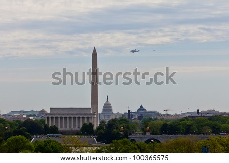 WASHINGTON, D.C. - APR 17: U.S. Space shuttle Discovery, mounted on the Shuttle Carrier Aircraft, has flown over the Washington Monument, Capitol and Lincoln Memorial in Washington, D.C. area on April 17, 2012 in Washington, DC