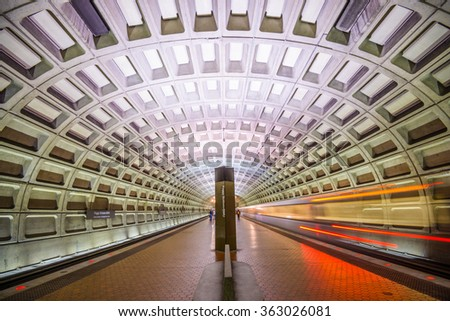 WASHINGTON, D.C. - APRIL 10, 2015: Trains and passengers in a Metro Station. Opened in 1976, the Washington Metro is now the second-busiest rapid transit system in the U.S. - stock photo