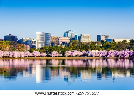Washington, D.C. at the Tidal Basin during cherry blossom season with the Rosslyn business distict citycape. - stock photo