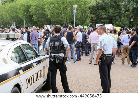 Washington, D.C. - July 07 2016: Secret Service keep a watchful eye on protestors gathered in front of the White House after recent police involved shootings of Alton Sterling and Philando Castile