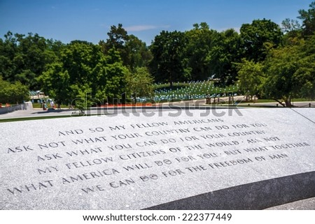 WASHINGTON, D.C. - JUNE 20, 2014: John Fitzgerald Kennedy Grave site with his Inaugural Address carved in the granite stones at Arlington National Cemetery. - stock photo