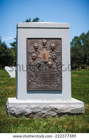 WASHINGTON, D.C. - JUNE 20, 2014: Memorial of the crew of Space Shuttle Challenger at Arlington National Cemetery. The Space Shuttle Challenger disintegrated after launch on January 28, 1986. - stock photo