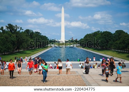 WASHINGTON, D.C. - JUNE 11, 2014: People enjoy sunny day in front of Lincoln Memorial with Washington Monument in the background. - stock photo
