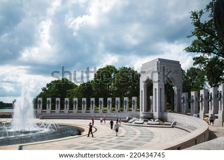 WASHINGTON, D.C. - JUNE 11, 2014: Tourists at World War II Memorial site. It is a national memorial dedicated to Americans who served in the armed forces and as civilians during World War II.