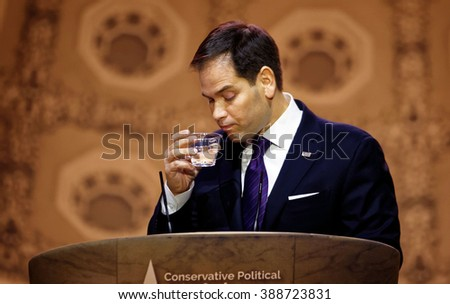 Washington, D.C. 5 March, 2014. Senator Marco Rubio of Florida pictured drinks water during the 2014 CPAC conference. Rubio is seeking the Republican nomination for President. photo by Trevor Collens