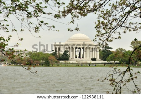 WASHINGTON, D.C. - MARCH 31: The Jefferson Memorial, with the tidal basin in the foreground, stands under cloudy skies during the Cherry Blossom Festival on March 31, 2012 in Washington, D.C.