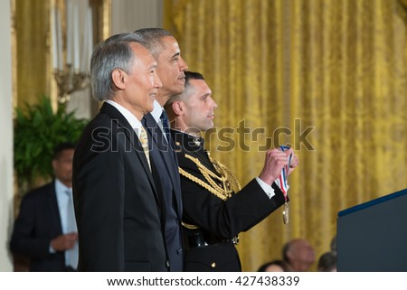 WASHINGTON, D.C. - MAY 19: President Obama awards Dr. Chenming Hu on May 19, 2016 in Washington, D.C. The ceremony recognized the contributions of 17 top scientists, engineers, and inventors. - stock photo