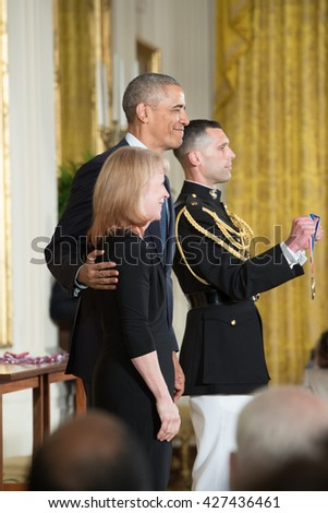 WASHINGTON, D.C. - MAY 19: President Obama awards Dr. Geraldine Richmond on May 19, 2016 in Washington, D.C. The ceremony recognized the contributions of 17 top scientists, engineers, and inventors. - stock photo