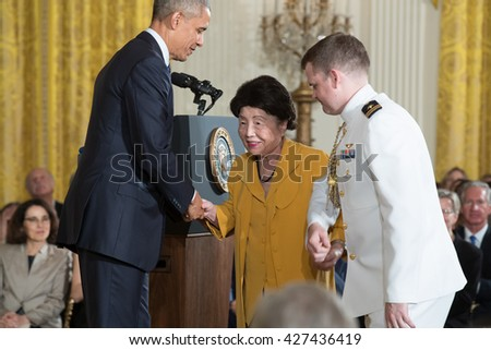 WASHINGTON, D.C. - MAY 19: President Obama awards Dr. Nancy Ho on May 19, 2016 in Washington, D.C. The ceremony recognized the contributions of 17 top scientists, engineers, and inventors. - stock photo