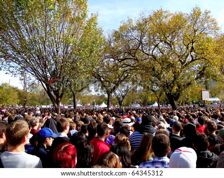 WASHINGTON, D.C. - OCTOBER 30: Hundreds of thousands gather on the National Mall for at The Rally to Restore Sanity and/or Fear on October 30, 2010 in Washington D.C. - stock photo