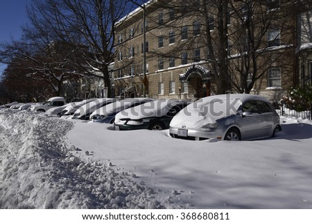 Washington, D.C., USA - January 24, 2016: Snow-covered streets, cars and houses in Washington after a two-day blizzard